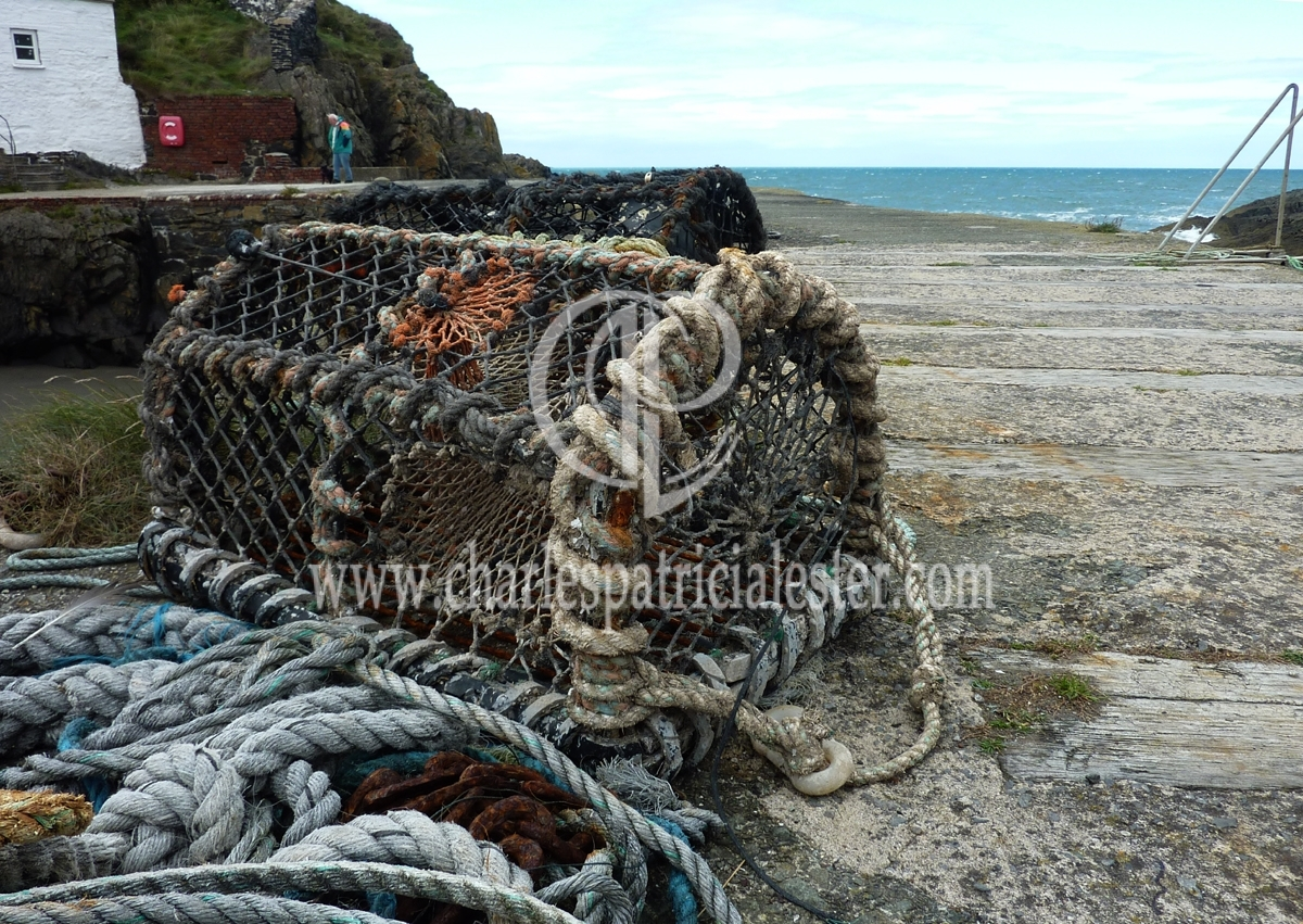 lobster-pot-on-harbour wall and the sea