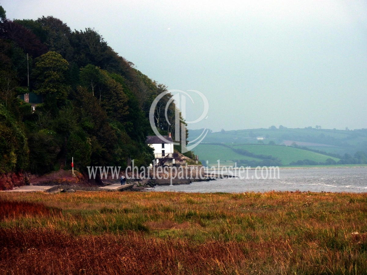 Dylan Thomas Boathouse in view of wind turbine